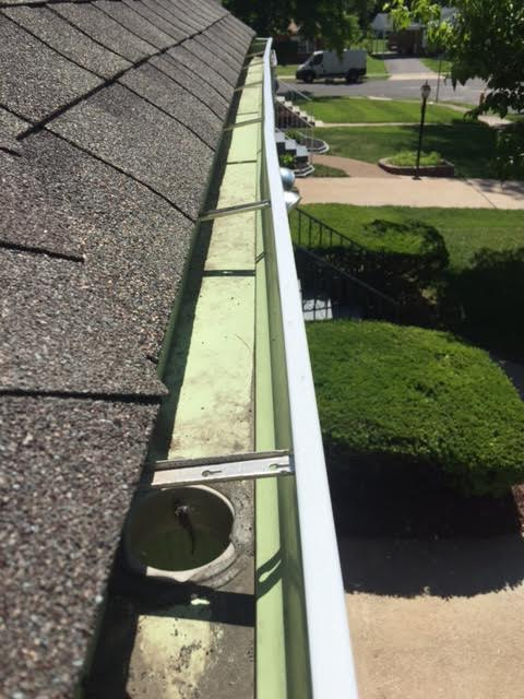 How To Clean Gutter Downspouts
